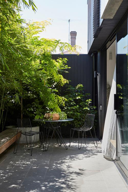 This charming courtyard in the centre of Melbourne is a study in achieving maximum impact in a small space.