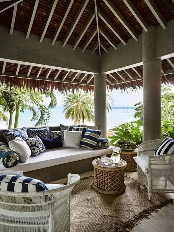 This dream-like Vanuatu property became a much-loved second home for Elizabeth and husband Michael. Bringing pattern to the nakamal extension are cushions in various fabrics, including a Manuel Canovas koi print and a Ralph Lauren stripe. The mat was made locally. Photographer: Anson Smart | Architect: Iain Halliday of Burley Katon Halliday