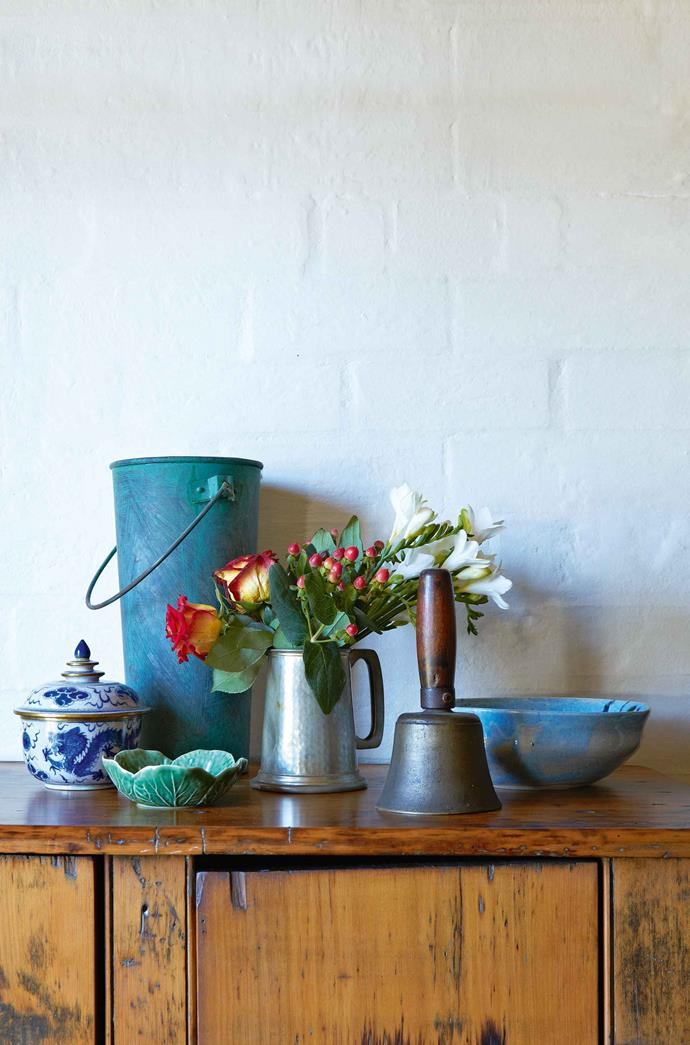 Antique finds, including a school bell from the region, are scattered throughout the house.