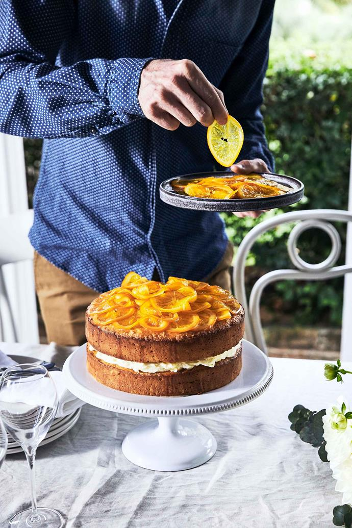 Thin slices of candied orange adorn the top of this celebratory cake.