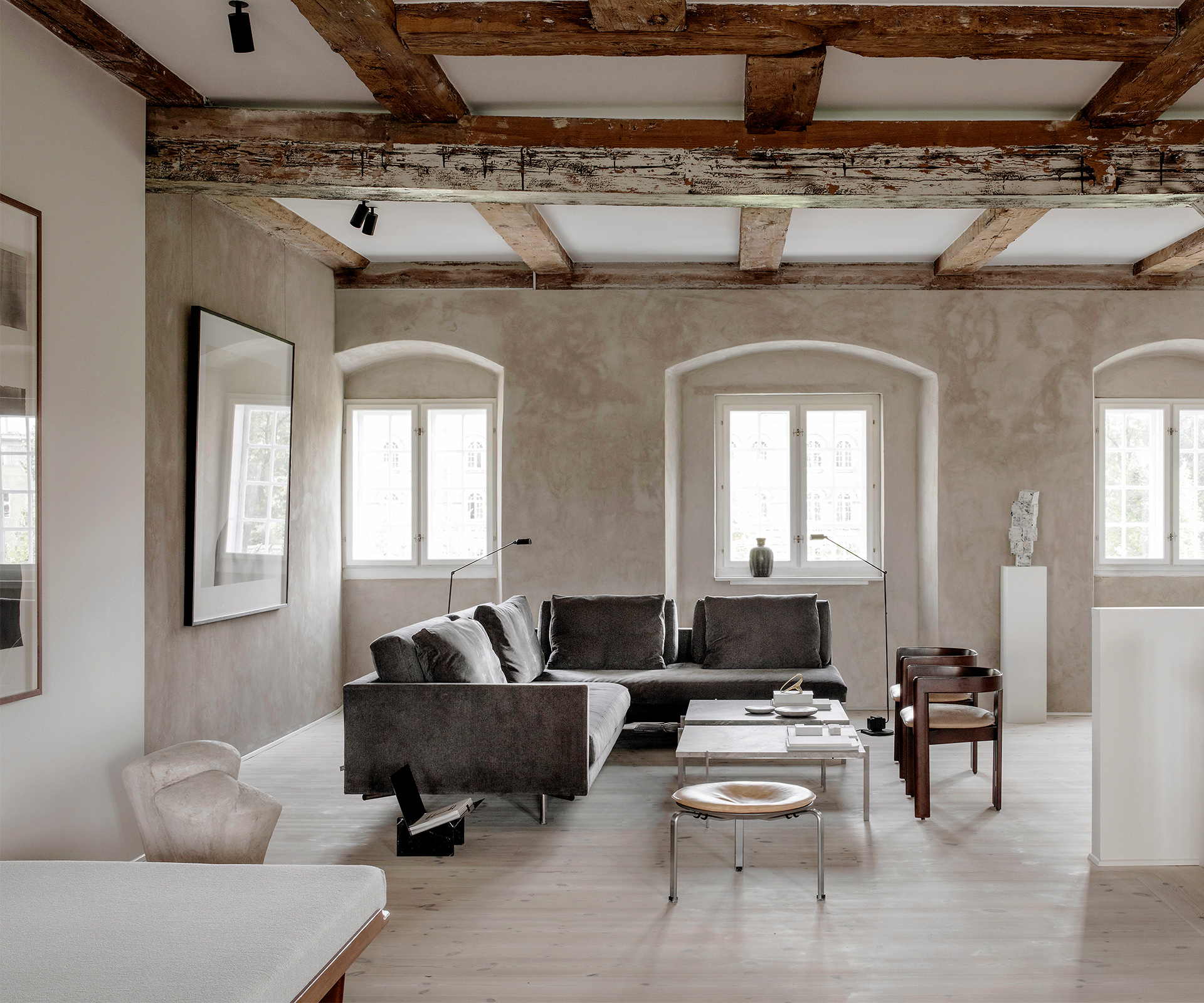 Exposed timber beams give this home an industrial edge