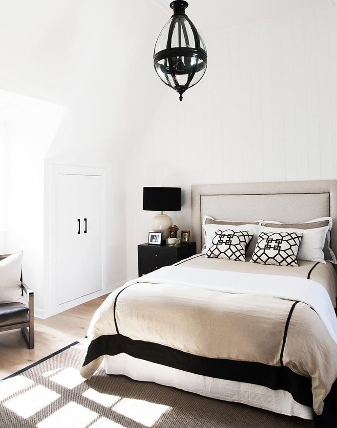 Built-in storage makes good use of the awkward shape created by the dormer window. Chair, Camerich. Bedside table and lamp, both Bloomingdales Lighting. Ceilling light, Emac & Lawton. Custom bedhead.