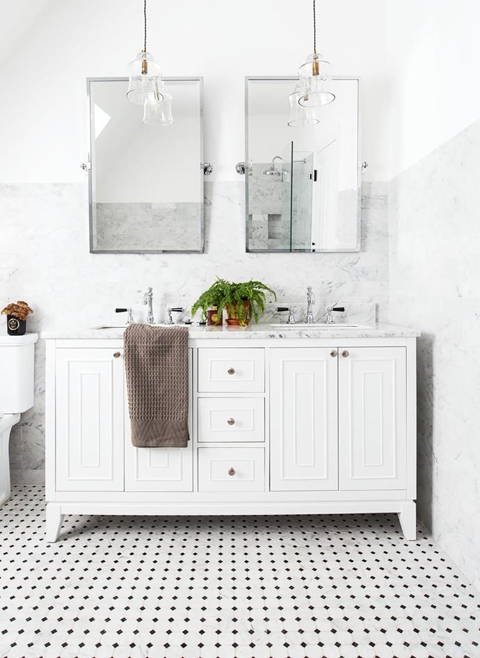 Carrara marble subway tiles, floor tiles and vanity benchtop are a luxurious touch. Tapware, Astra Walker. Pendant lights, Light Up Willoughby. Smart buy: Kensington pivot mirrors, $404 each, Pottery Barn.