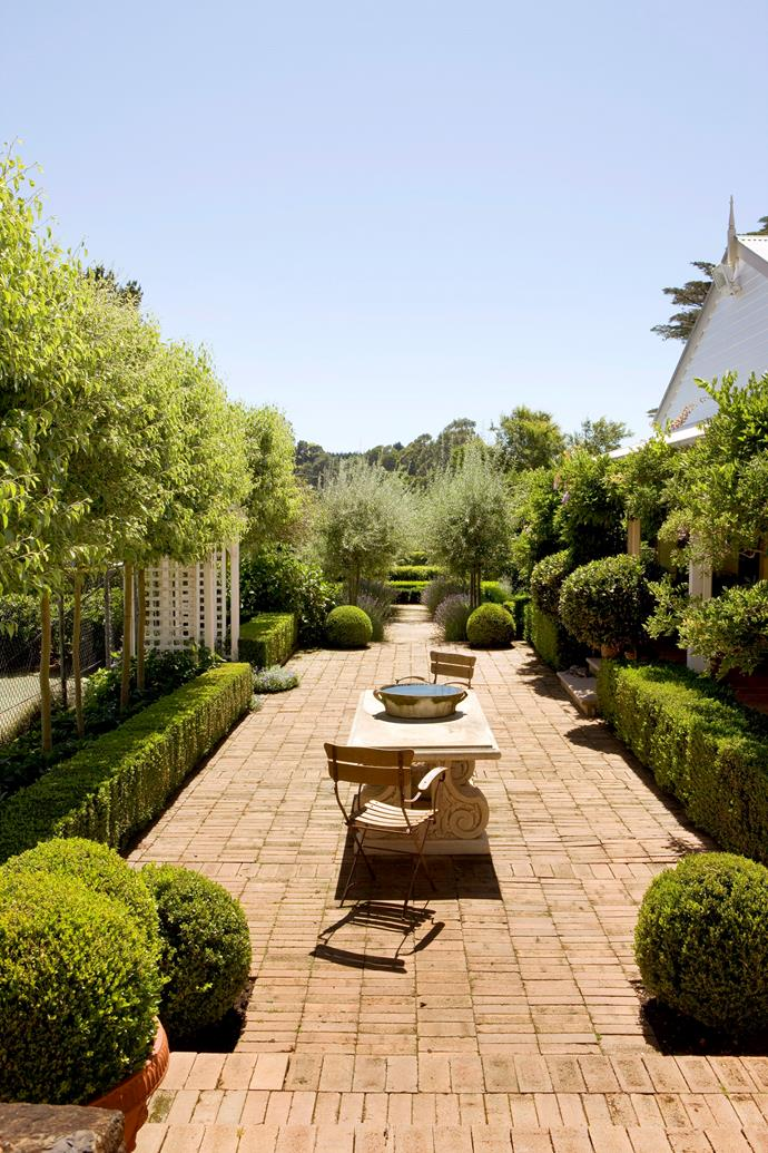 Topiary balls add soft curves to this otherwise structured courtyard.