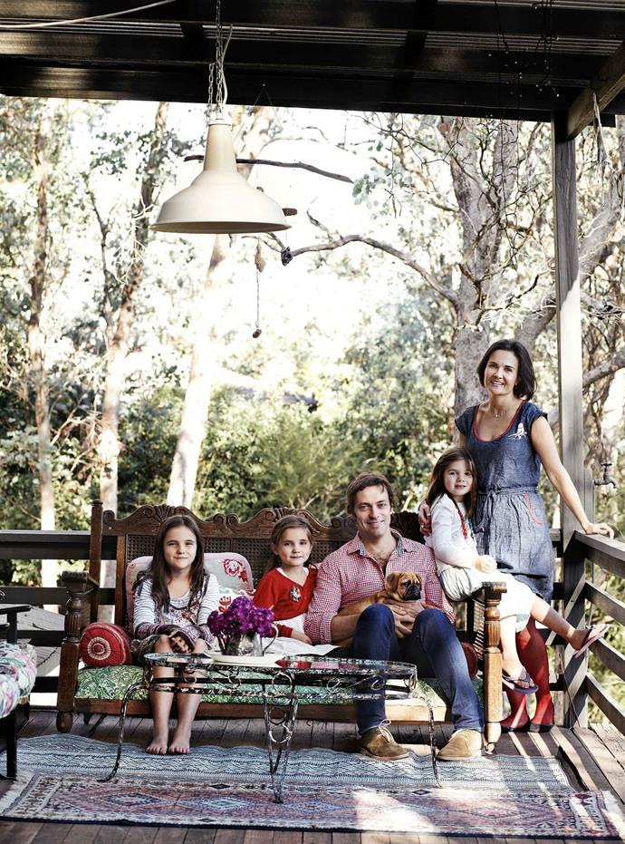 """Paula and Peter Mills on the deck with (from left) Lia, Rosie and Liberty, and Bella the pugalier puppy. Paula and her lawyer husband Peter, both from South Africa, lived in London for several years. Melbourne, their new destination, soon proved an ideal choice. """"We were very pleased with our decision to come here,"""" Paula says."""