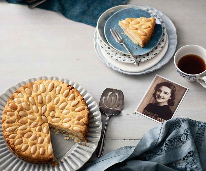 Belgian bun cake with cup of tea