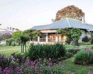 Farmhouse surrounded by farmland and flower garden