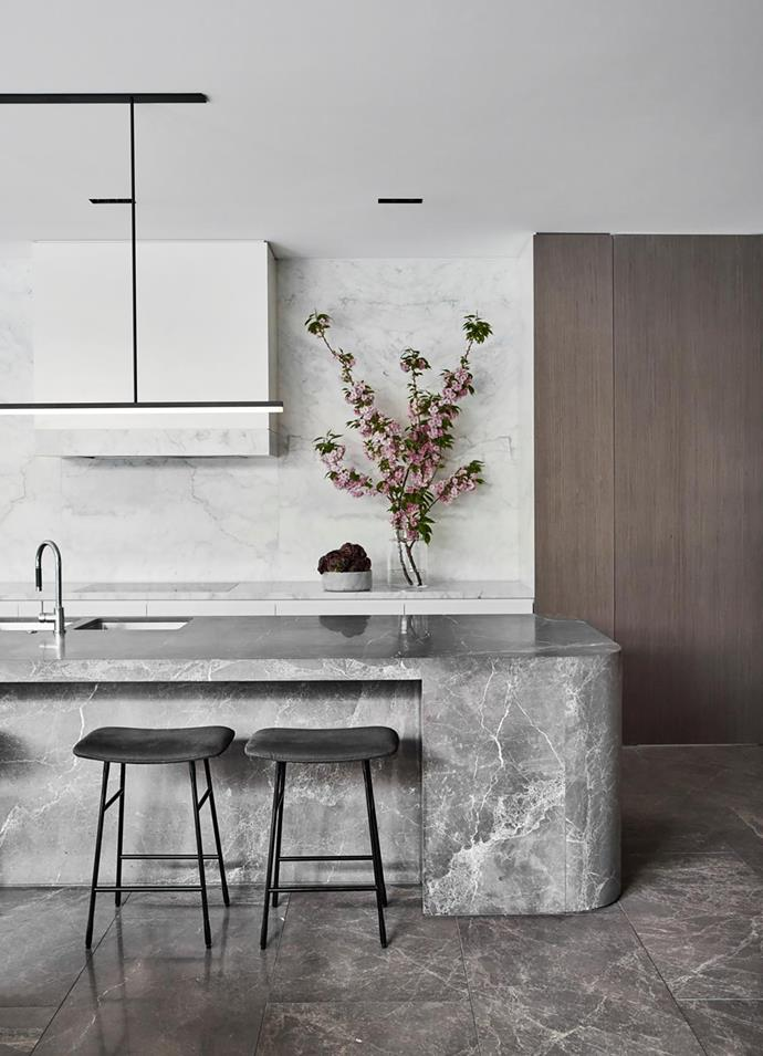 Benchtop Honed Calacatta marble. Splashback Honed Elba marble from CDK Sink Franke 'Kubus' undermount. Tapware Teknobilli 'OZT7137' pullout mixer in Chrome from Reece. Living Divani 'Hinge' stools from Space.