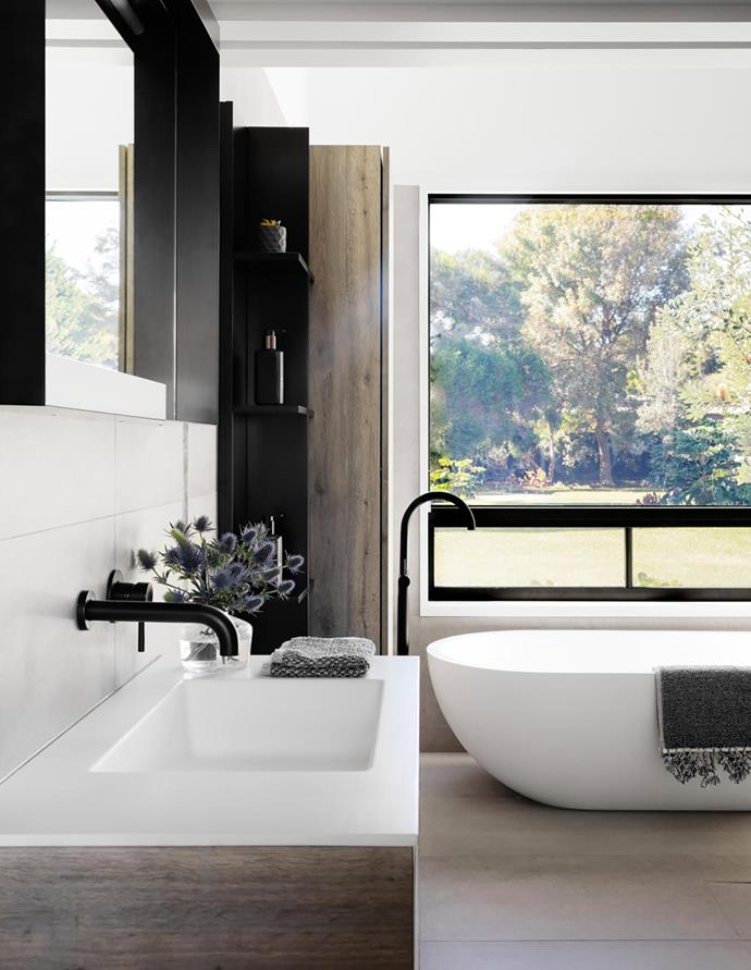 The home's main bathroom features a Vasca 'Libera 3D' back-to-wall bath teamed with an Abey Gareth Ashton 'Lucia' bath filler all from Disegno Casa.