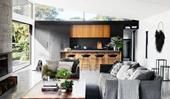A relaxed concrete and charred timber beach house fit for family living