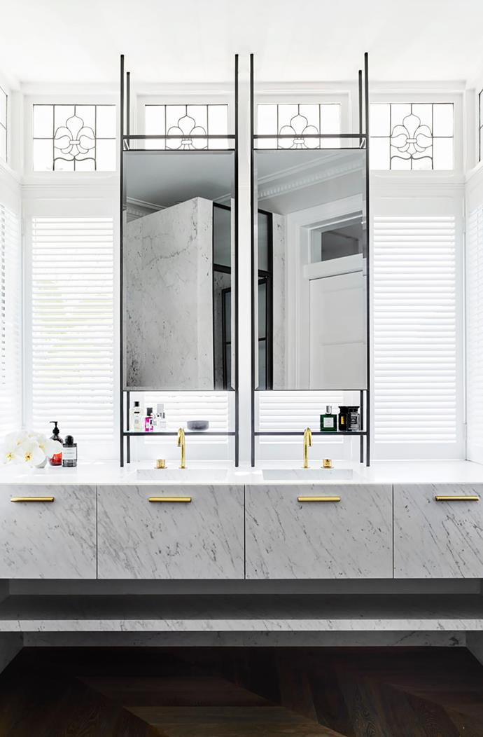Vanity Bianco Carrara marble from CDK Stone. Mirror Custom designed by Decus. Basin tapware Vola '590' in Raw Brass finish.