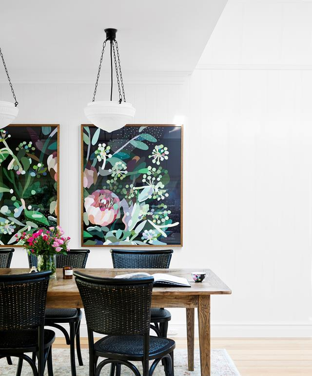"A pair of floral artworks perfectly match the furniture in this elegant [dining room](https://www.homestolove.com.au/block-contestants-renovate-heritage-queenslander-home-19196|target=""_blank""), elevating it to another level."