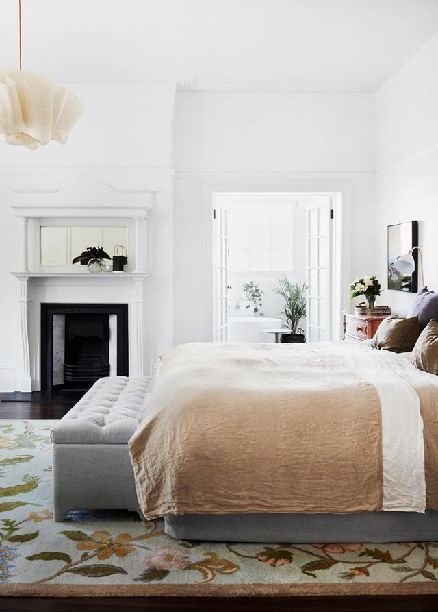 "This beautiful [master bedroom](https://www.homestolove.com.au/heritage-home-sydney-receives-sensitive-update-20172|target=""_blank"") is underpinned by an elegant rug that showcases a subtle approach to incorporating floral design into a space."