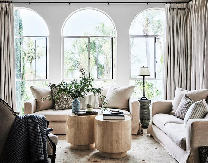 In the living room the sofas are dressed in linen slipcovers with custom cushions in Busatti fabrics. Throw in Busatti wool plaid. The inlaid side tables were sourced by the late Frank Grill. Hezari rug from Cadrys.