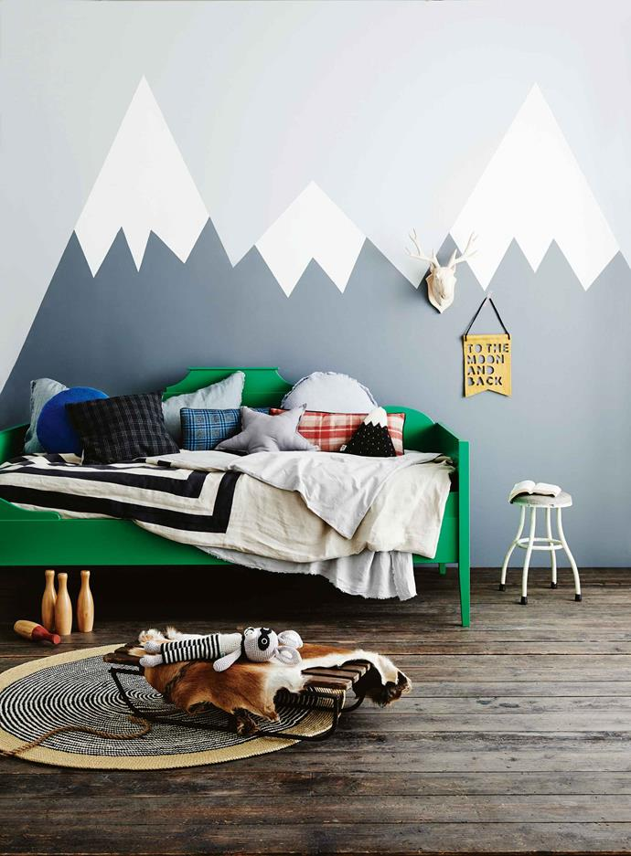**FAR HORIZONS**<P> <p>In this bedroom, a mountainous horizon has been painted directly onto the wall. The background paint colour is Dulux Grey Pail, with mountsains in Guild Grey and snow caps in Vivid White. The adventurous scene has been softened with a collection of cushions and a punchy shot of green.<p>