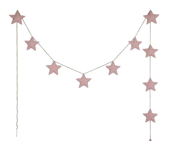 "Mini star garland by Numero 74 in dusty pink, $45, from [Smallable](https://fave.co/2PxhHKi|target=""_blank""