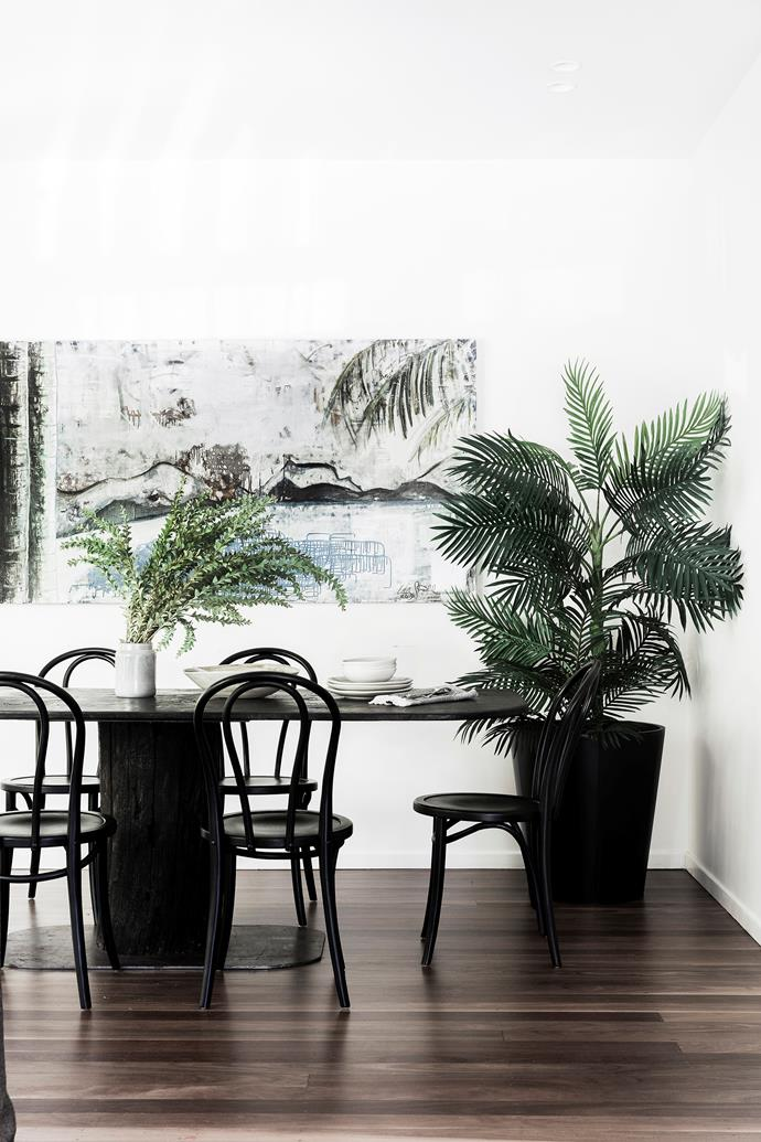 **Dine out on your favourite art:** Art can anchor a space and there's no better spot to showcase a favourite piece than in the dining area, where you can linger and enjoy it without distraction. A statement work can also recreate that special feeling of eating out in the comfort of your home.