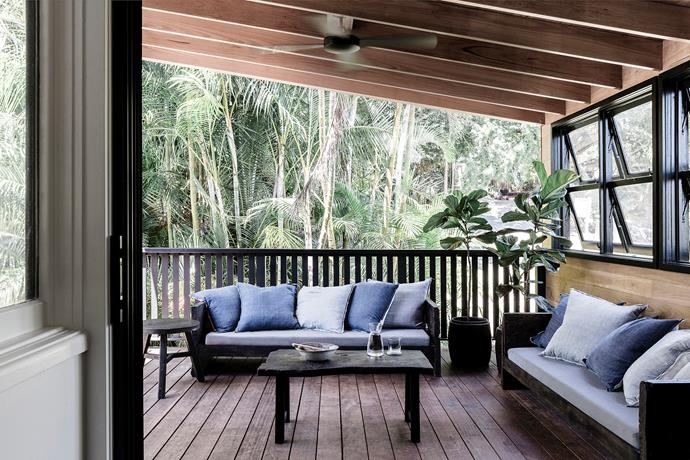 Bangalow palms provide a lush outlook from the patio, which features blackbutt ceiling beams and ceiling fan to keep the air moving when humidity is at its highest.