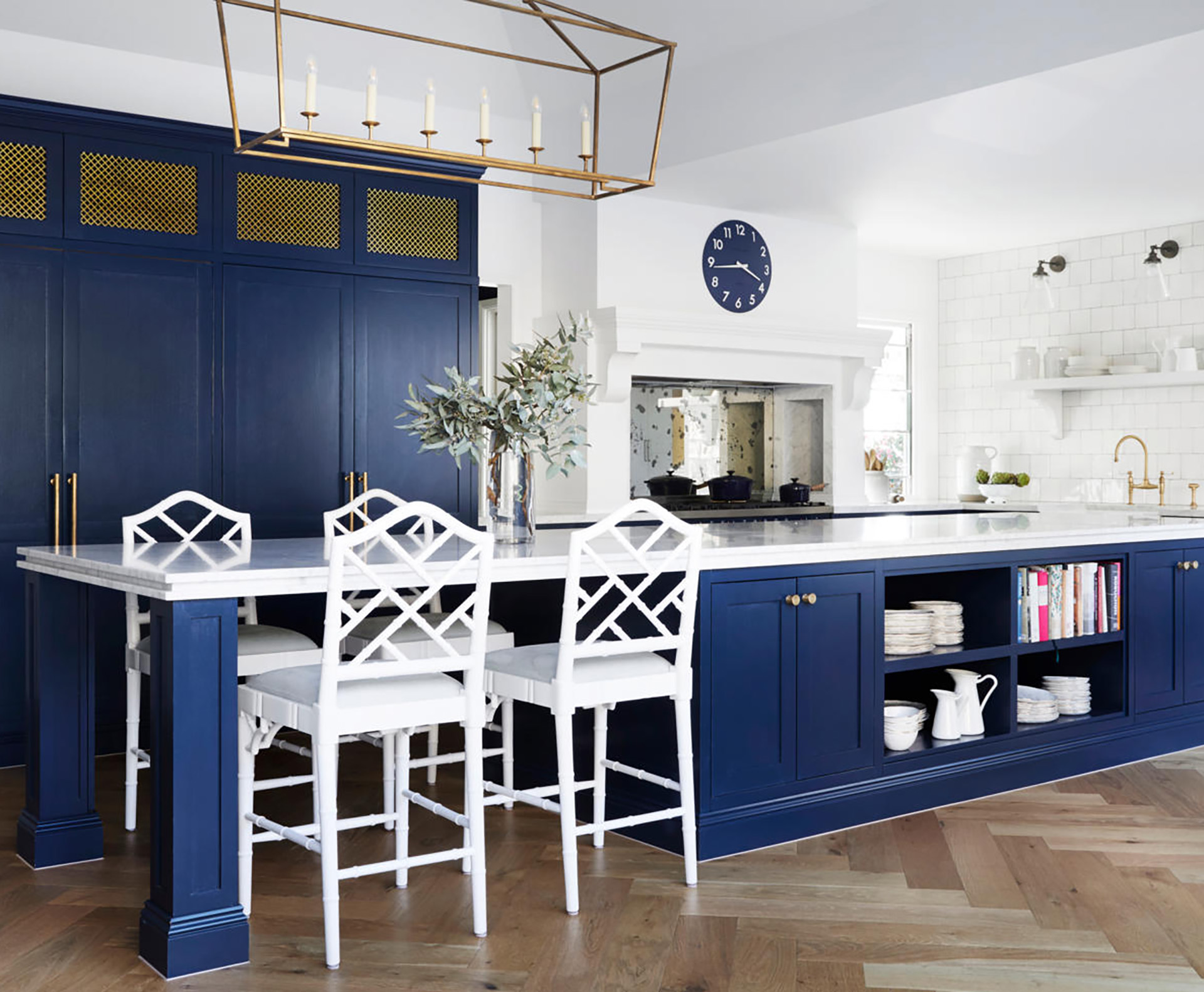 A classic Shaker-style kitchen with blue joinery and brass hardware