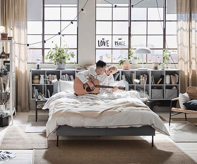 Couple playing guitar in bed with IKEA furniture