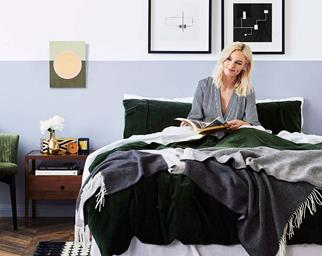 Women sitting in bed reading a book