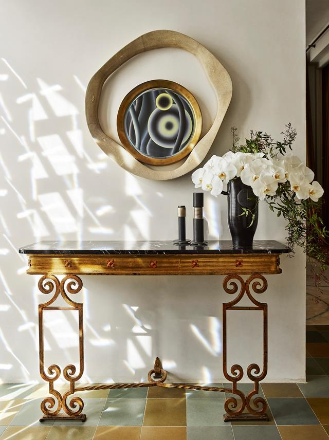 "A European sensibility pervades this [Melbourne home](https://www.homestolove.com.au/melbourne-home-with-a-european-sensibility-19643|target=""_blank"") with a roster of sumptuous pieces collected over time and assembled with a deft hand by Christian Lyon. Christian pulled vintage items from his retail gallery Editeur,  including this vintage Spanish, gilt iron console with a marble top."