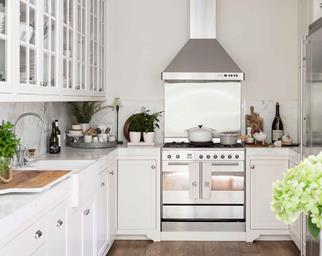 Freestanding stainless steel oven with stove in white kitchen