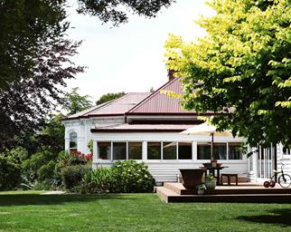 Exterior shot of Tasmanian country home with lawn and deck