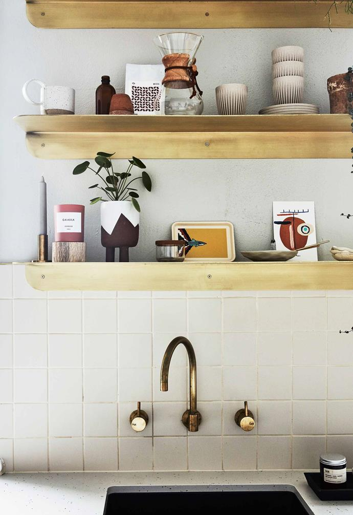 "Brass shelves with rounded corners do double time as decorative element and storage. They coordinate beautifully with the wall-mounted unsealed-brass tapware from [Sussex Taps](https://sussextaps.com.au/|target=""_blank""