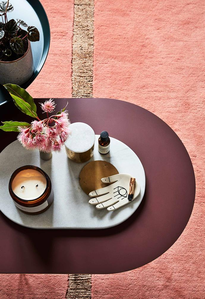 "In the living area, a Tom Dixon 'Stone' board sits atop a Muuto 'Airy' coffee table in Plum from [Living Edge](https://livingedge.com.au/|target=""_blank""
