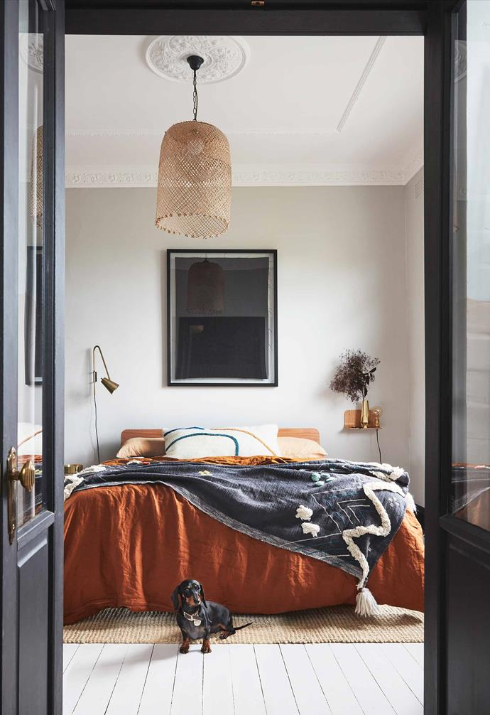 "Stronger, earthy colours with black accents feature in here. The glass-panelled French doors lead into the adjacent sunroom. Sophie and Josh chose a stunning yet cost-effective bed frame by [Koala](https://au.koala.com/|target=""_blank""