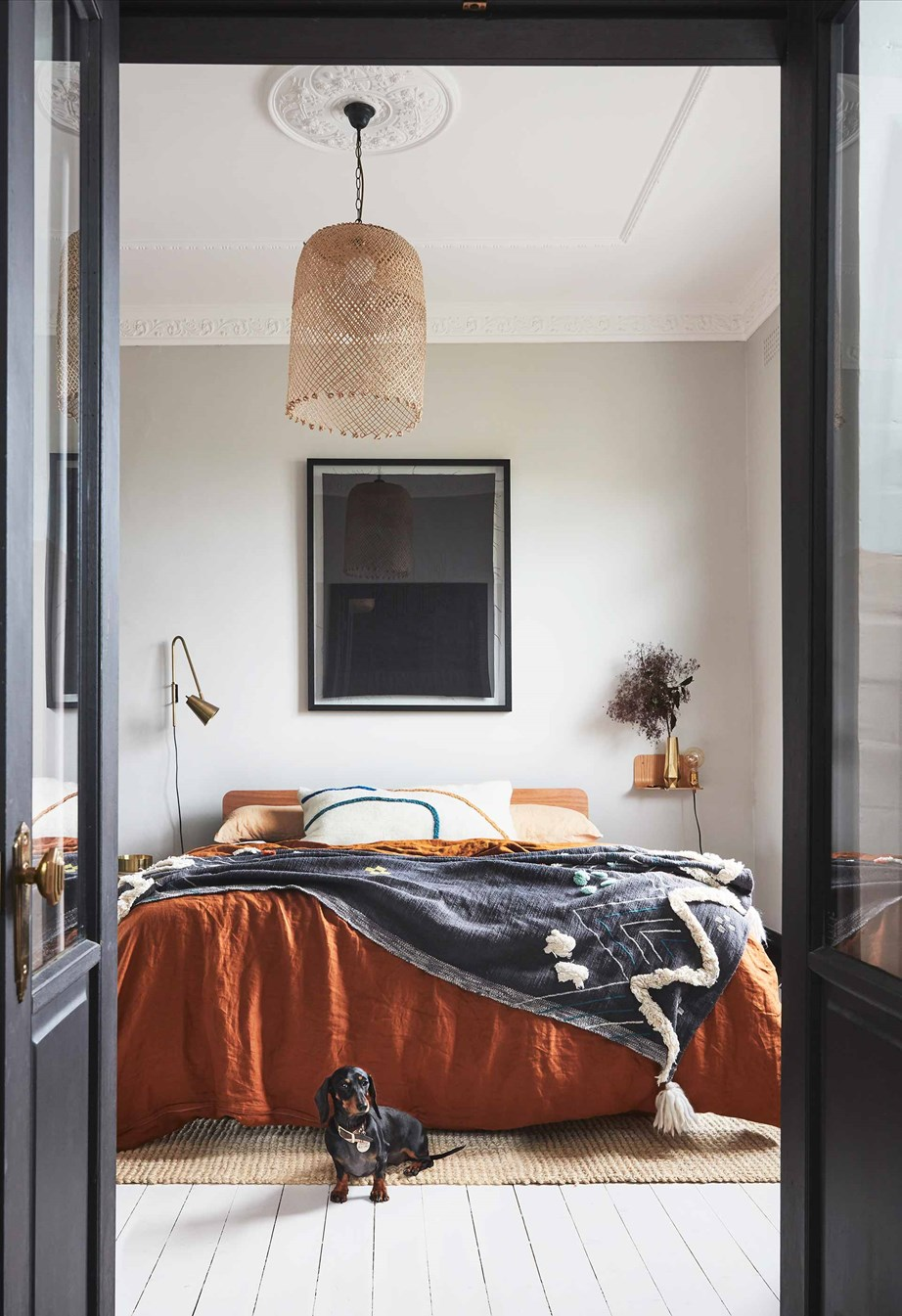 "Stronger, earthy colours with black accents feature in this bedroom. Bed linen by In Bed X Tribe, a cushion by LRNCE and a rug from [Freedom Furniture](https://fave.co/3imMJit|target=""_blank""