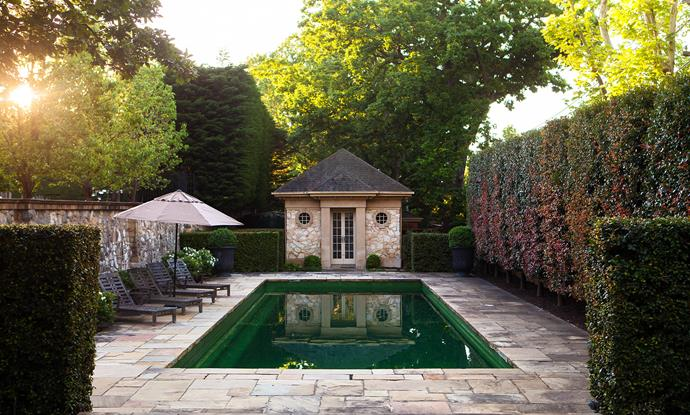 A tall lilly pilly hedge gives privacy and a sense of enclosure in the pool area. The pool house designed by Stephen Akehurst provides important balance and scale within the space.