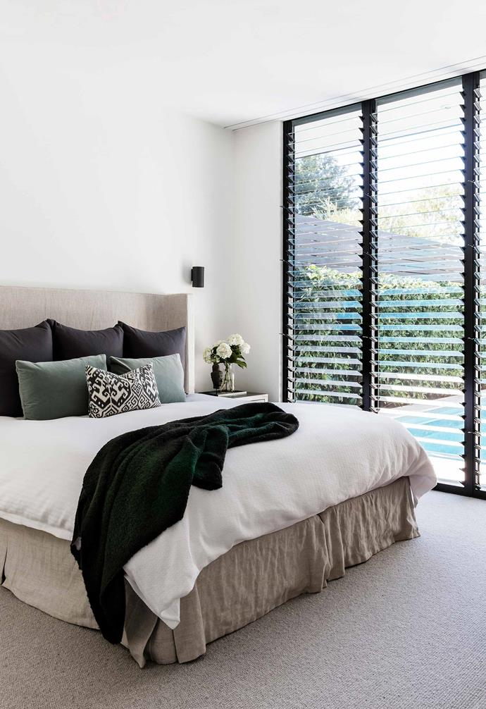 "**Main bedroom** Close proximity to the pool required a flexible window solution and glass louvres fit the bill. The bedhead's linen fabric is from [Westbury Textiles](https://www.westburytextiles.com/|target=""_blank""