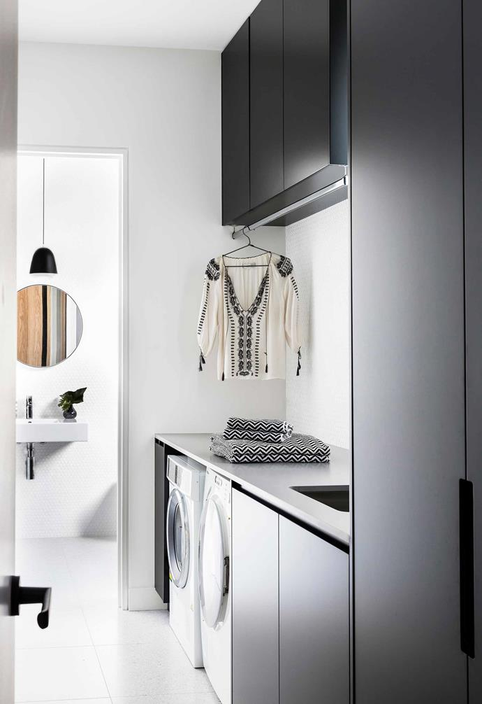"**Laundry** The cabinetry is the same as the kitchen's. Caesarstone Sleek Concrete benchtop. Caché pendant light (in guest toilet) from [Great Dane](https://greatdanefurniture.com/|target=""_blank""