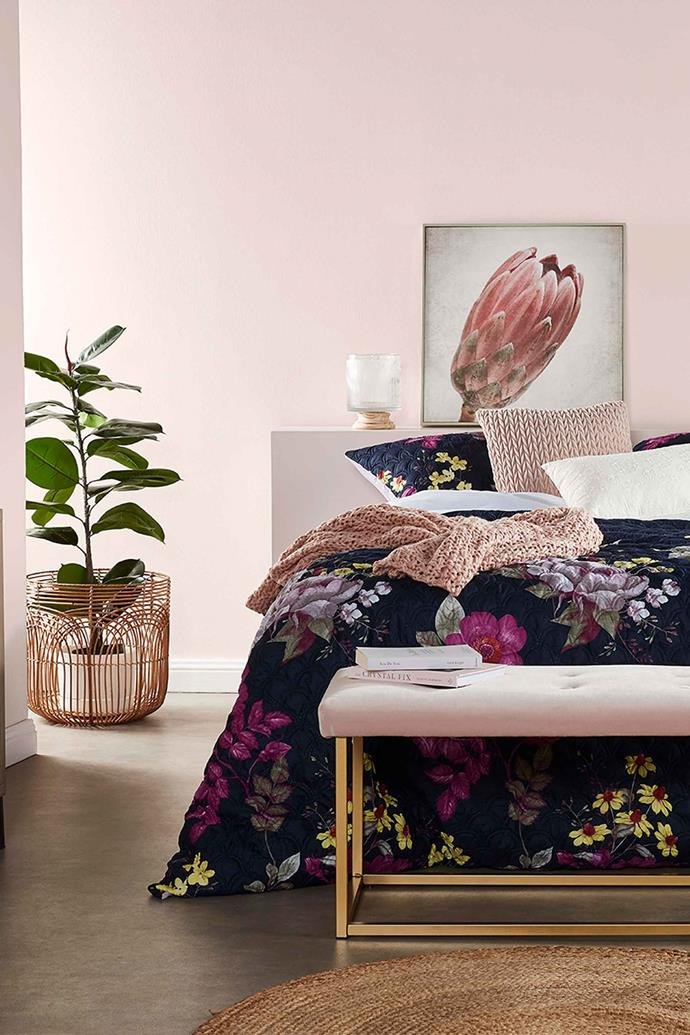 """Updating your bedspread can a huge impact on a room, and is a fantastic way to add some spring vibes,"" says Gina. This bedroom has been styled with the House & Home Pinsonic **Quilt cover set** in 'Amelia', $39-49, a Kodu velvet **bench ottoman** in blush, $49 and the House & Home 'Chunky knit' **throw** in blush, $29."