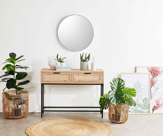 "Give your [entrance hallway](https://www.homestolove.com.au/warm-welcome-8-inspiring-entrances-and-hallways-1811|target=""_blank"") a makeover with the Kodu 'Nadi' **console table**, $89, the House & Home **jute rug**, $29, botanical **framed canvases** from $29. ""Artwork is a great way to set a colour palette and overall feel for a space by adding interest and personality to the walls,"" says Gina."