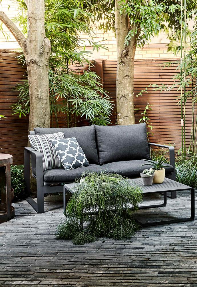 "Tulloch two-seater sofa in Charcoal and matching coffee table, both from [Eco Outdoor](https://www.ecooutdoor.com.au/|target=""_blank""