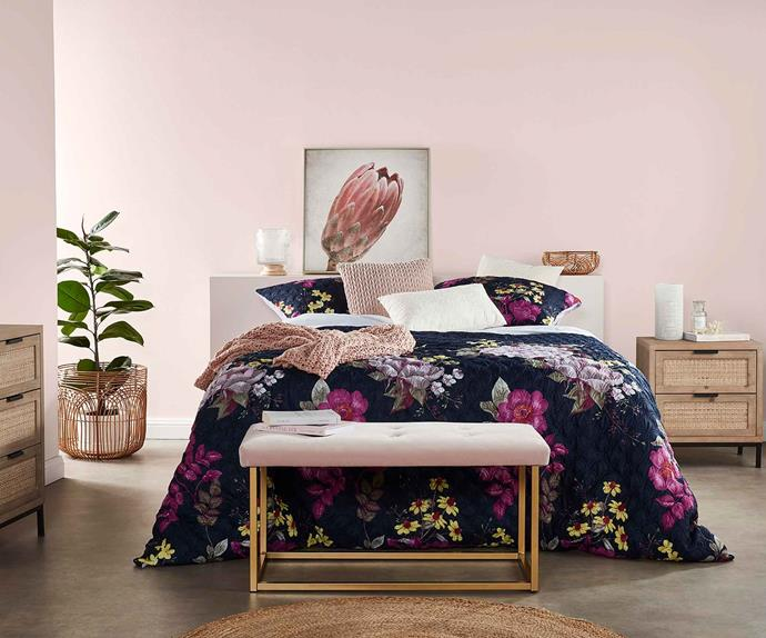 Bed made up with floral bedding from Big W