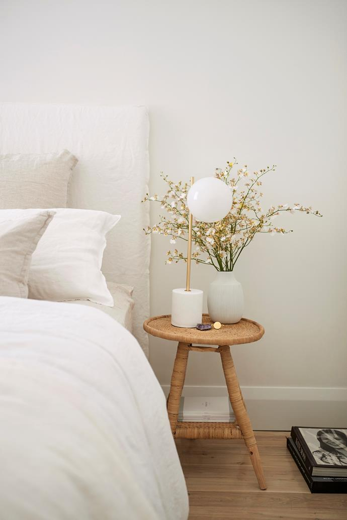 A West Elm lamp and a vase from Papaya adorn Hayley's bedside table.