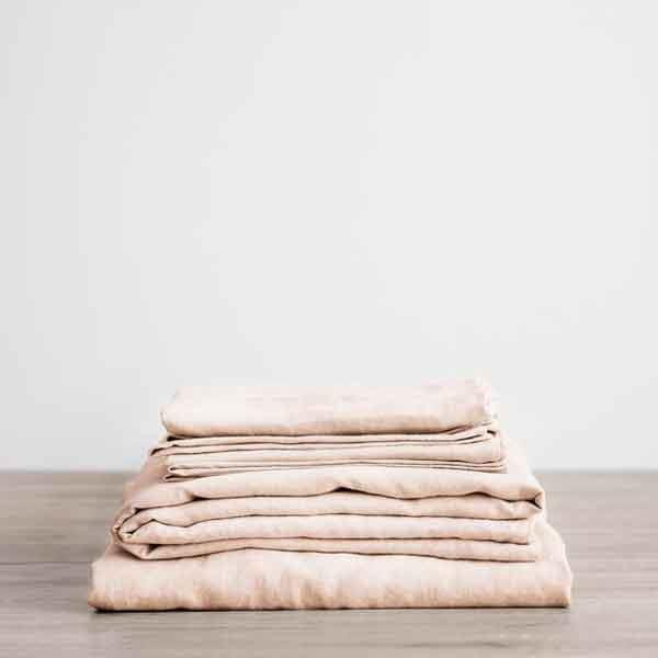 "Linen **sheet set** in blush, starting at $195 (for single), from [Lilly & Lolly](https://www.lillyandlolly.com.au/Linen-Sheet-Set-Blush-27p2274.htm|target=""_blank""