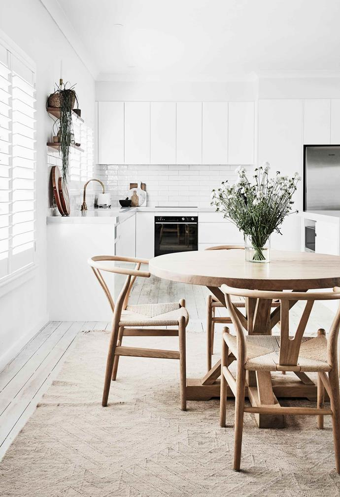 "**Dining area** ""Dan and I have quite varied tastes, so we just blended them together and hoped for the best,"" says Natalie. Bruges timber dining table and Wishbone rattan chairs, [MCM](https://mcmhouse.com/