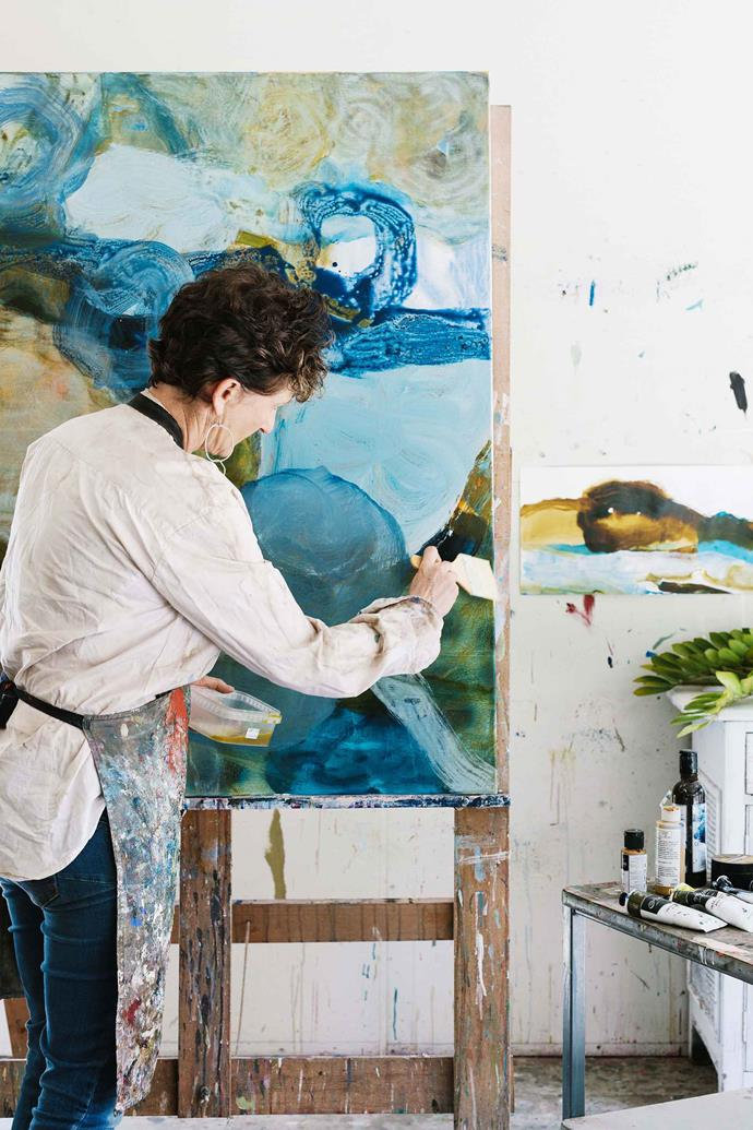 Amy working on a painting called The Dam.