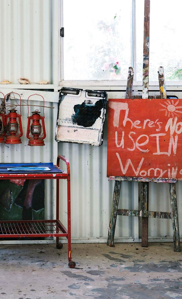 A motto painted by Coco when she was eight years old has pride of place in Amy's studio.