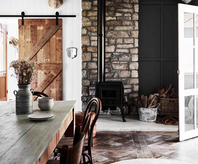 Open plan farmhouse dining and living room with fireplace