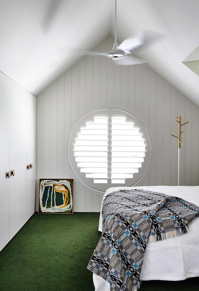 "Ventilation and natural light were key considerations in the design of the converted attic bedroom in this [Arts and Crafts-inspired home](https://www.homestolove.com.au/modernist-arts-and-crafts-home-17491|target=""_blank""). The circular plantation window adds a stunning visual feature to the room.<br><br>"