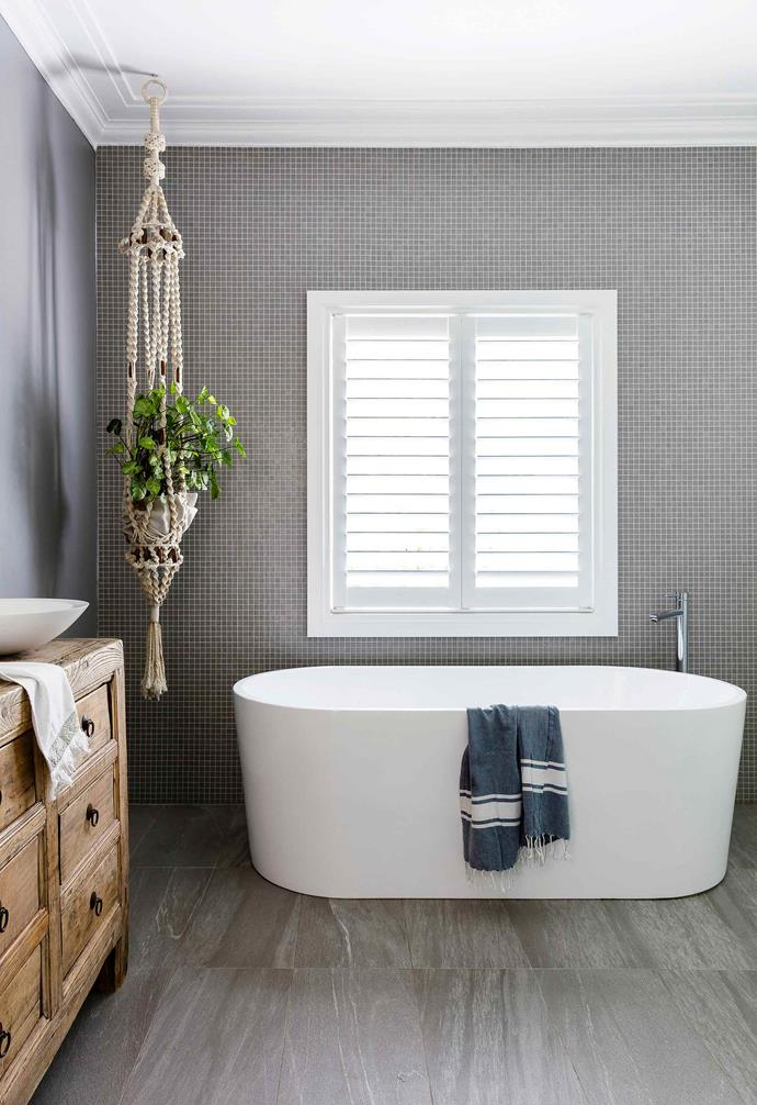 Plantation shutters are the perfect addition to a bathroom space as they also provide privacy from the outdoors while allowing for ample natural light.