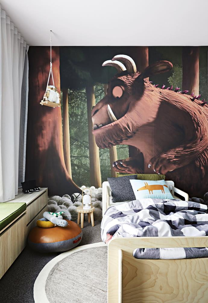 "Inspired by the iconic children's book *The Gruffalo*, the kid's bedroom in this revamped [century-old Edwardian home](https://www.homestolove.com.au/a-modern-extension-revived-this-century-old-edwardian-home-7147|target=""_blank"") features a detailed wall mural of the Gruffalo himself. The artwork is paired with a simple grey carpet and rug, as well as a timber bedframe.<br><br>"