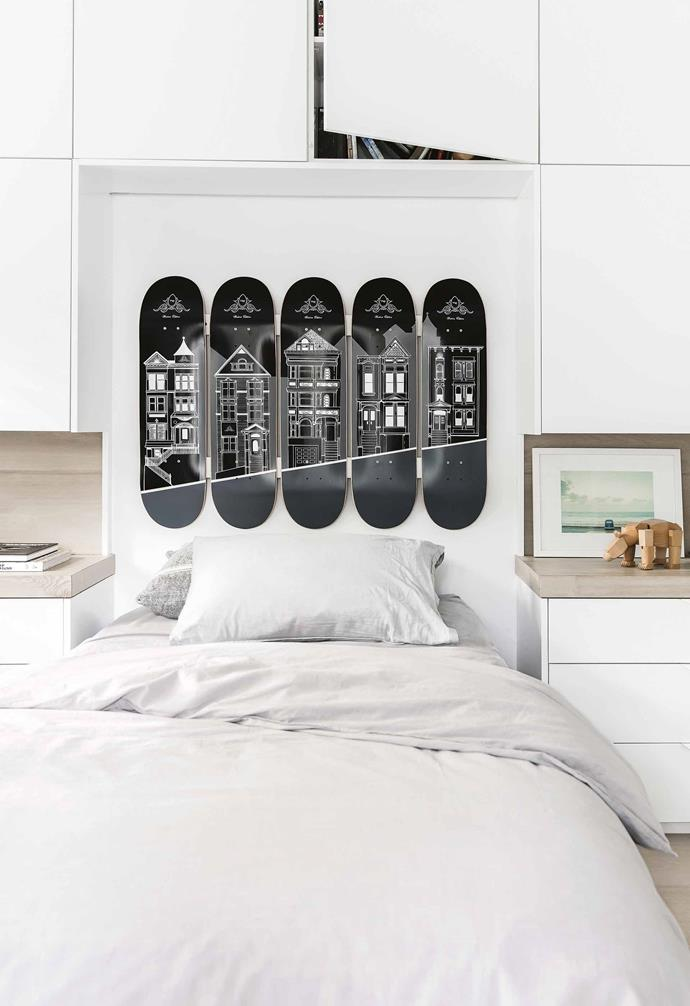 "Wanting to still incorporate a theme in the kid's bedroom in this [weatherboard beach house](https://www.homestolove.com.au/bellamumma-nikki-yazxhi-home-tour-16880|target=""_blank""), a series of custom skateboards were installed over the bed to take the place of a bedhead.<br><br>"