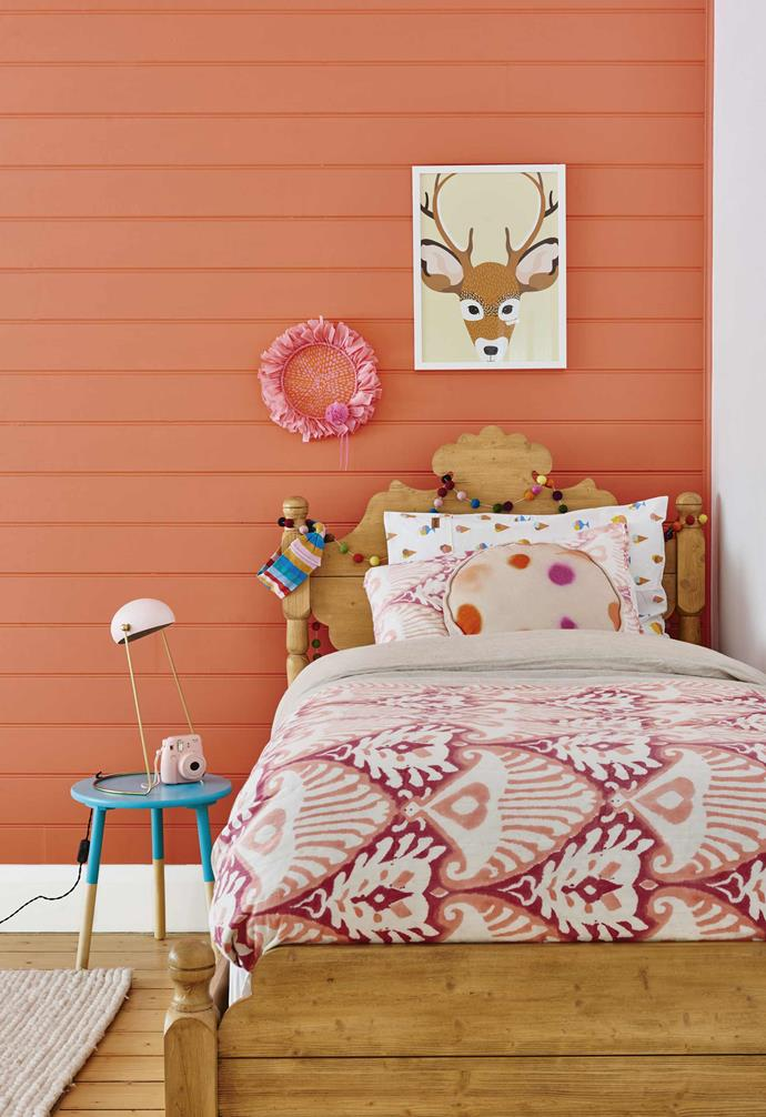 "In the loving Hamptons-meetes-Scandi renovation of this [Barwon Heads bungalow](https://www.homestolove.com.au/californian-bungalow-barwon-heads-17909|target=""_blank"") vibrant pops of colour run throughout the home. In the kid's room a panelled feature wall was painted orange for a dramatic look.<br><br>"